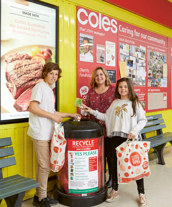 REDcycle CEO Liz Kasell with Hugo and Lulu Harvey recycle soft plastics at the Coles supermarket at Southland
