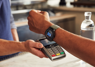 Close up shot of person using their Samsung watch to make a payment