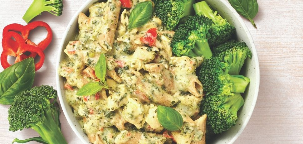 A bowl of pesto chicken with wholemeal pasta, herbs and broccoli